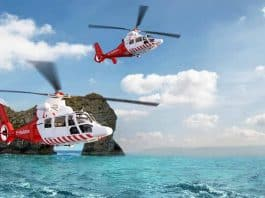 Two rescue helicopters travelling over water