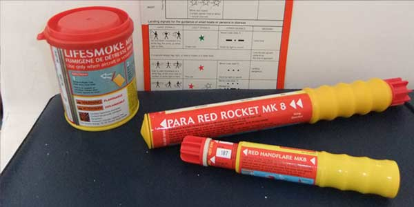 Smoke float, rocket parachute flare and red hand flare