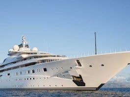 Superyacht at anchor with clear blue sky above