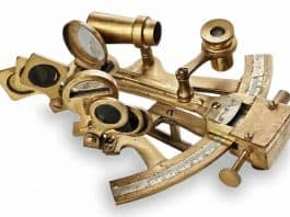 Brass sextant isolated on a white background