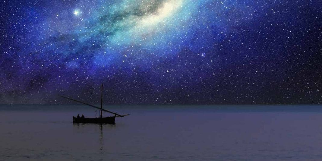 Fishing boat under stars with the milky way visible