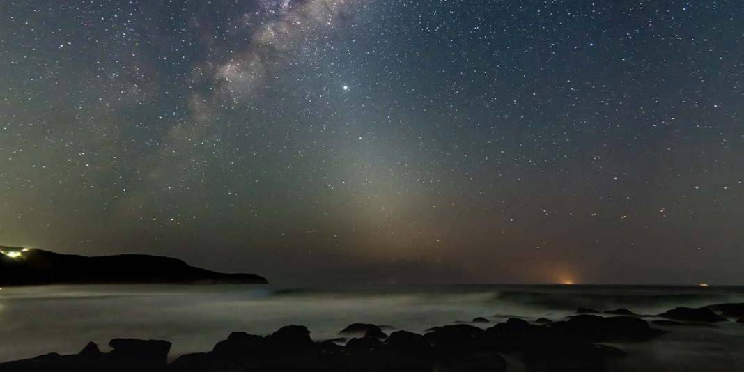 Coastline with stars and the milky way visible above