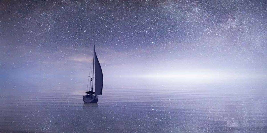 Sailing boat with a starry sky overhead