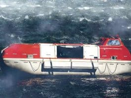 Partially enclosed lifeboat in rough weather