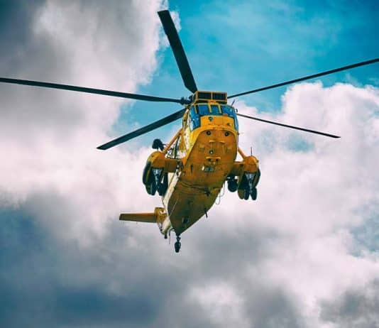 Search and rescue helicopter hovering overhead